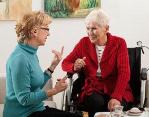 care worker elder in wheelchair walker home services